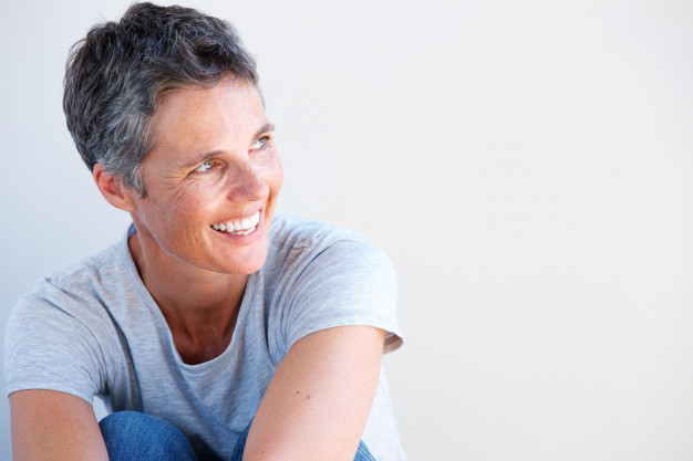 Close up beautiful older woman smiling against white background 33839 11447